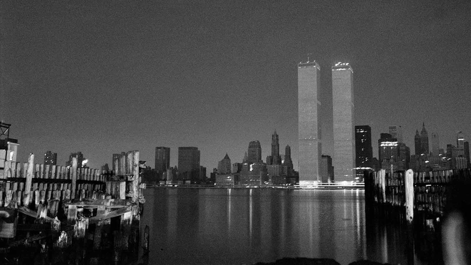 Seen from across the river in New Jersey, only the base of the World Trade Center's twin towers flickered with light.