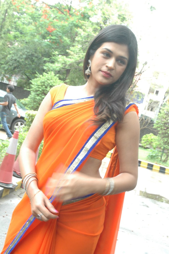 Shraddha Das Hot Stills In Orange Saree