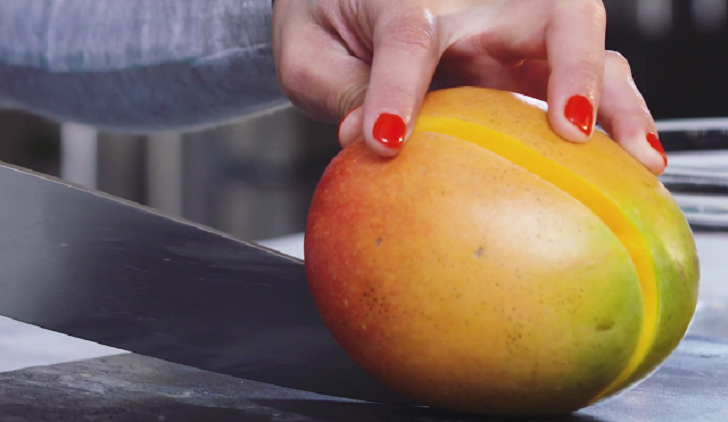 Woman cutting a mango