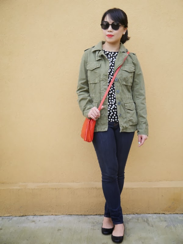Army jacket, polka dot sweater, octagon oversize sunnies, and touches of red