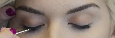 Applying oil on eyelashes