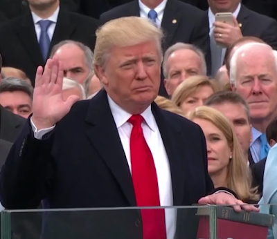 President Donald Trump swearing in ceremony inauguration Bible Justice John Roberts hand up