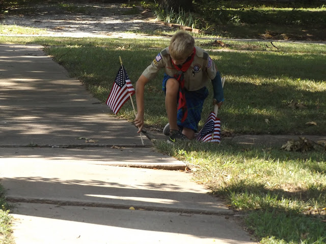 Baldwin City residents get a flag from the local Boy Scout Troop.
