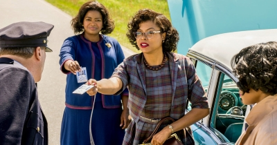 Octavia Spencer, Taraji P. Henson, and Janelle Monae as mathematicians who overcome racism during the Jim Crow era to help put the first man into space in Hidden Figures (2016).