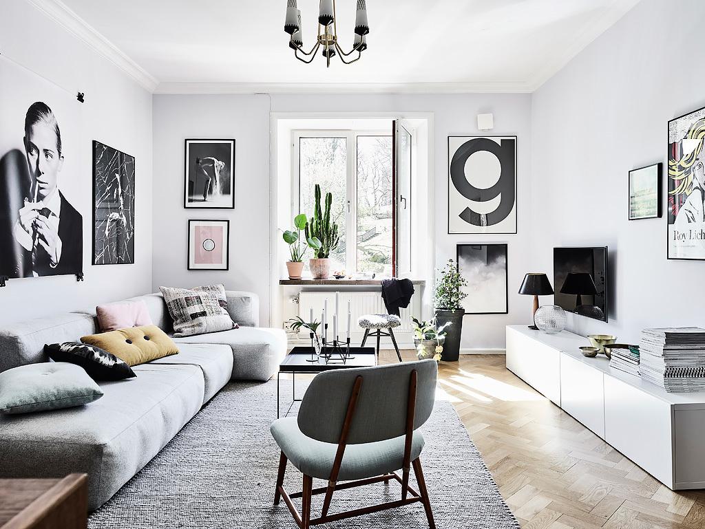 salon estilo nordico, sofa, cojines nordicos, funda cojín, portavelas, velas, foto blanco y negro, estilo escandinavo, estilo nordico, decoracion nordica, interiorismo, barcelona, alquimia deco,
