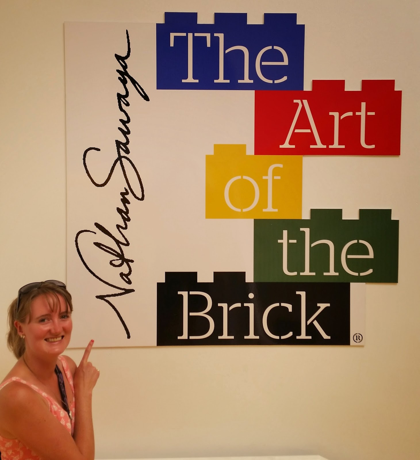 Cath in front of Art Of The Brick Poster
