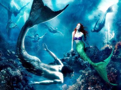 Fiesta océanica de sirenas y tritones en el fondo del mar.