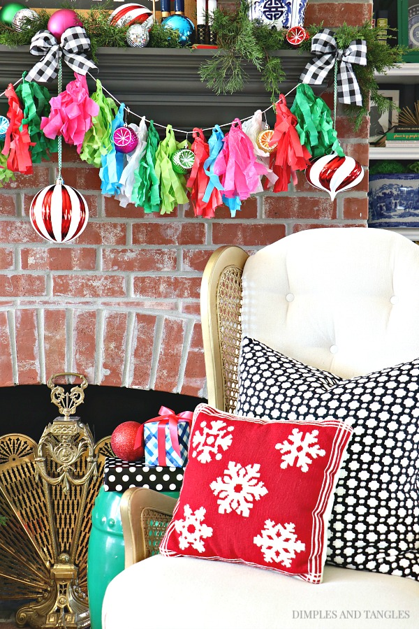 vintage cane wingback chair, christmas decorations, christmas mantel, vintage brass fireplace screen