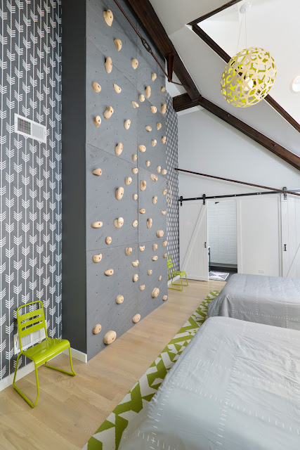 Rock climbing wall in bedroom in Church conversion to chic private home