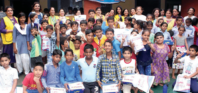 Alliance Club Mother Teresa delivered shoes to children