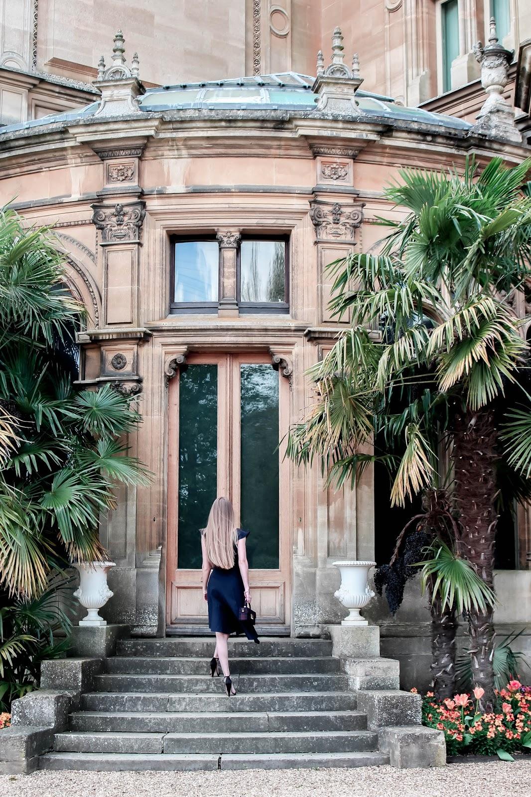 Photoshoot Elegant Dress Walking up to Grand Doors