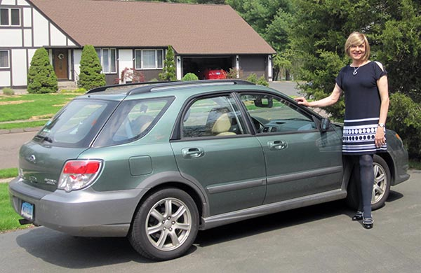 This is the only photo I have of me and my Subaru. I must get more photos with the favorite car I ever owned.