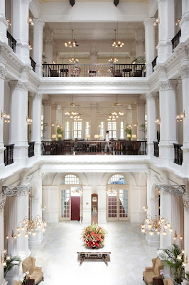 Source: Raffles Hotel, Singapore. The Grand  Lobby, Raffles Hotel, pre-renovation.