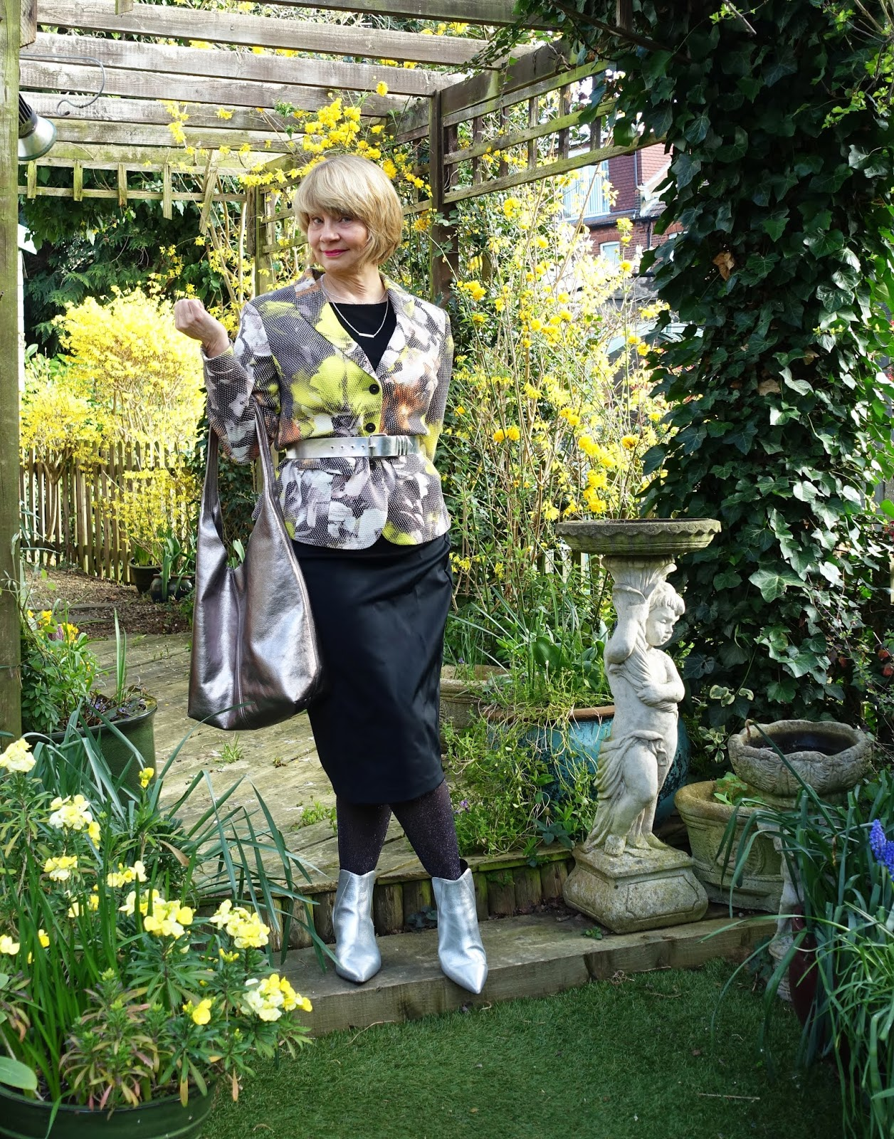 Is This Mutton blogger Gail Hanlon in thrifted print jacket and black top and skirt with silver accessories