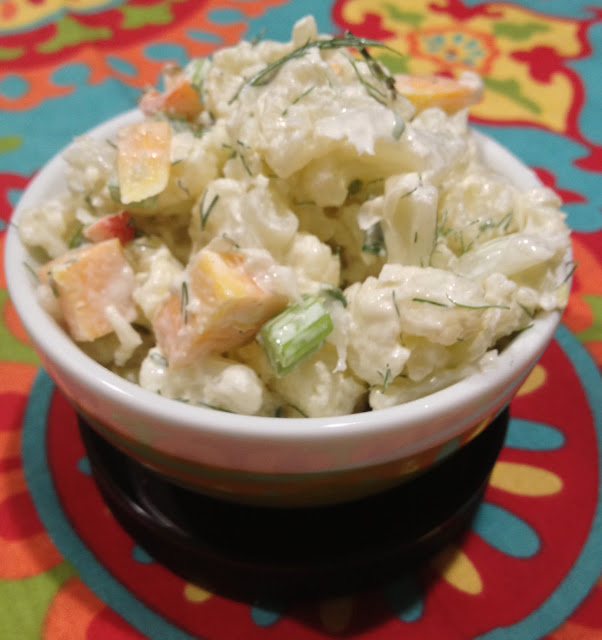 Bowl of potato like salad made from cauliflower