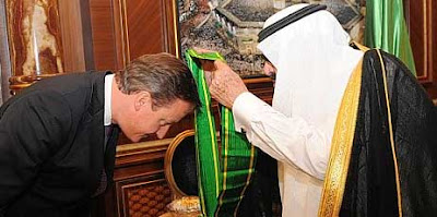 Prime minister David Cameron receives the King Abdullah Decoration One from King Abdullah of Saudi Arabia in Jeddah, November 6, 2012.