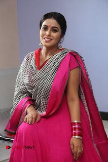 Actress Poorna Pictures in Red Salwar Kameez at Jayammu Nischayammu Raa Teaser Launch  0174