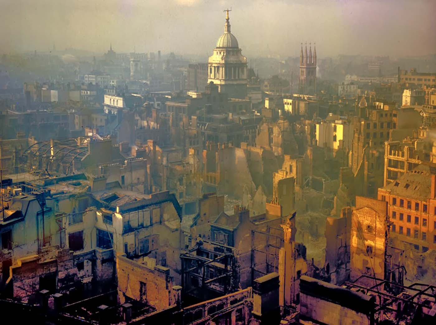 The spire of the Central Criminal Court - better known as the Old Bailey - rises defiantly while all around it buildings have become jagged shells in a landscape scarred by the relentless German bombings. 1940