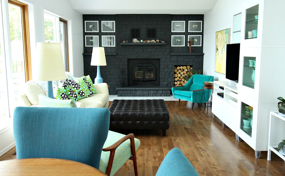Living room with grey fireplace, marimekko pillows, lotte lamps