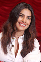 Priyanka Chopra in White Shirt and Colorful Skirt at Baywatch Press Conference  15th May 2017 ~  Exclusive 12.jpg