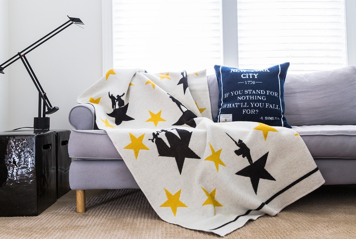 photo of the Hamilton blanket and pillow on a couch