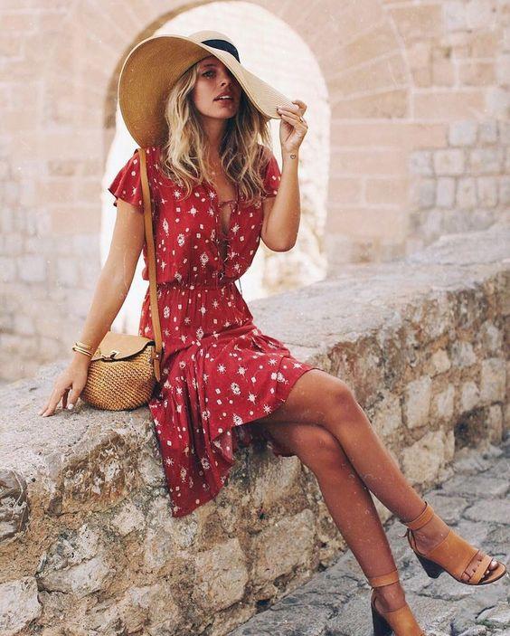 summer red outfit red printed dress basket bag tan heel sandals and floppy hat tash oakley