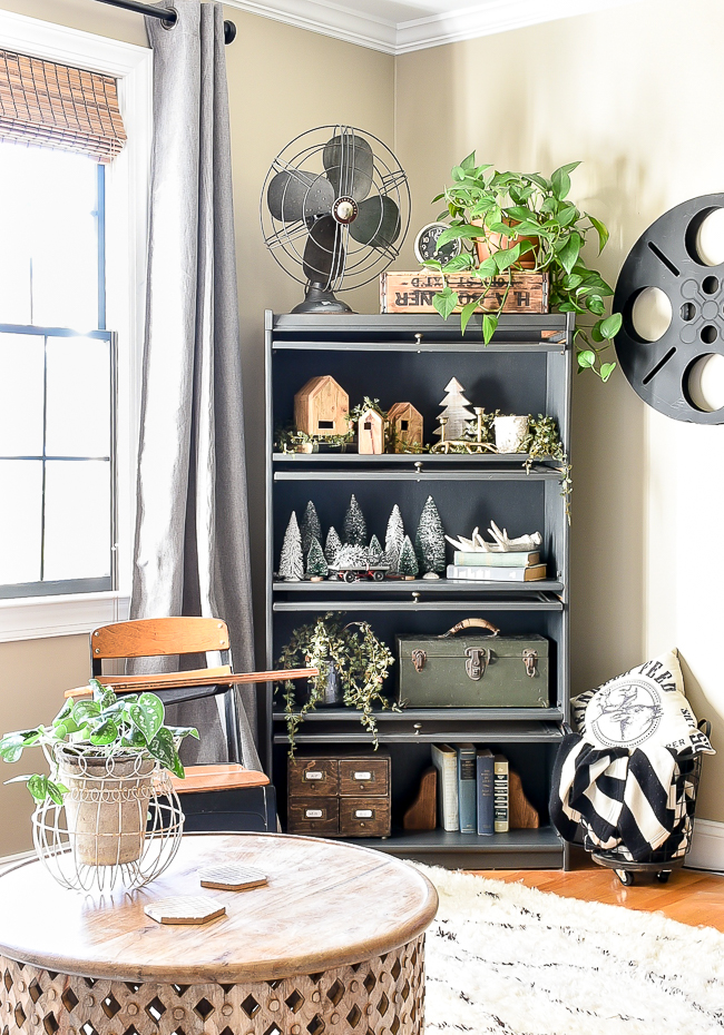 Bookshelf styled with neutral Christmas decor