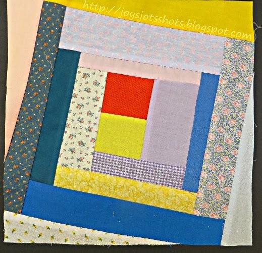 http://joysjotsshots.blogspot.com/2014/02/quilt-shot-block-17-wonky-log-cabin.html