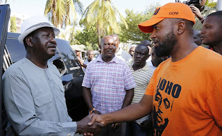 Hassan Joho with the ODM leader Raila Odinga at the Mombasa international airport. PHOTO | Courtesy 25/03/2017
