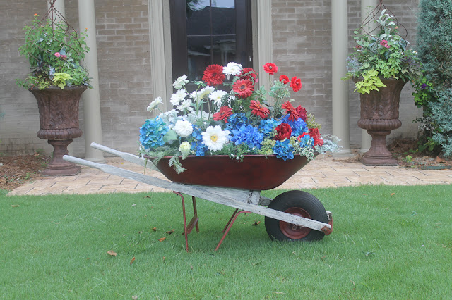 flowers in a wheelbarrow