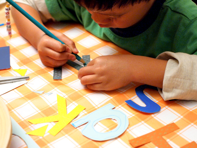 Use colored pencils to decorate paint chip letters