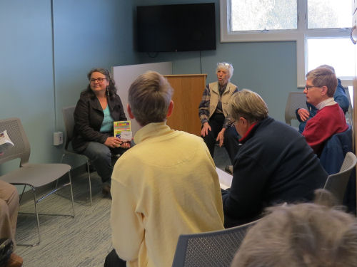 author Joan H. Young discussing her books in a small group setting
