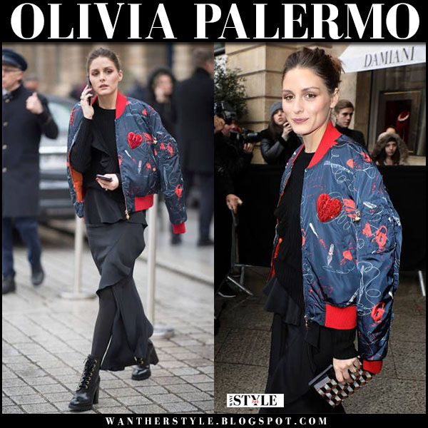Olivia Palermo in blue printed bomber  jacket, black skirt and black lace up boots prada fashion week style january 22