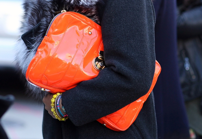 New York Street style orange patent clutch