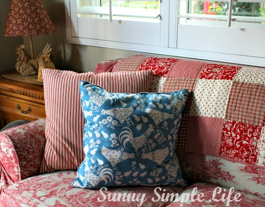 red and white couch, red and white quilt