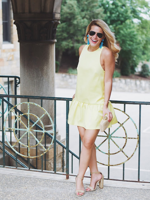 H&M Yellow Satin Ruffle Hem Dress with Steve Madden sandals and Tuckernuck tassel earrings