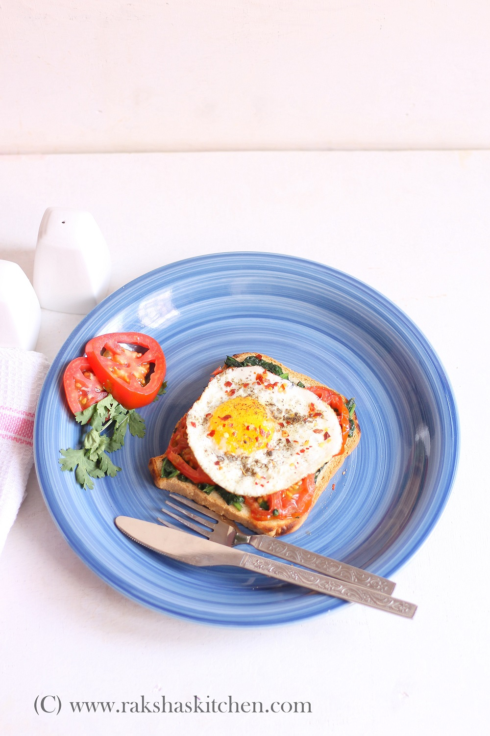 Open toast with egg, tomato and spinach