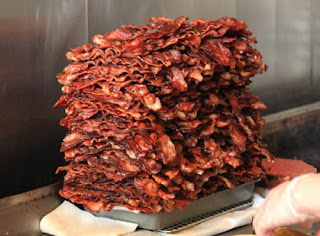 Huge pile of neatly-stacked bacon