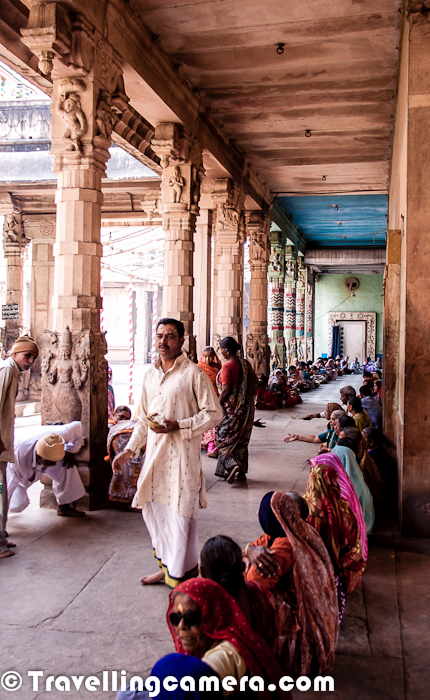 During first weekend of April'2012 we were in Virndavan, which is also known as town of Temples in India. During this visit, we had a quick visit to different temples in early morning. Shri Rangji Temple was the first one...The very first Photograph shows main gate of Shri Rangji Temple in Vridavan and the photograph above shows the next gate to the main temple. Architecture of this temple resembles with South Indian Temples and most of the priests were from South. Overall environment of the temple was quite peaceful.Sri Rangji Mandir is dedicated to Lord Sri Goda-Rangamannar. Goda or Andal is popularly known in South India was a famous 8th century Vaishnava saint who had composed 'Tiruppuvai' which centers around her love for her beloved Lord Krishna and his leela bhoomi Vrindavan. She pines for him, fasts for him, sings songs in his praise and wants to attain him by marrying him. Lord Ranganatha who is none other than Krishna answers her prayers by becoming her bridegroom. In Sri Rangji Mandir, Lord Krishna is present as the bridegroom with a walking stick in his hand as is the custom in a traditional south Indian marriage. To his right is Andal and to his left Garuda, the vahana of Lord KrishnaWhen we reached inside the temple, there were multiple rows of the folks who were lined up for Prasadam at the temple. Curd-rice were being served at Ranganatha Temple in the morning. He had some and it was enough for us in breakfast :)Andal had expressed three wishes in 'NachiyarTirumozhi'. Her first wish was to spend her life at the feet of Lord Krishna in Vrindavan. Her second wish that Lord Krishna accept her as his bride came true when she married Lord Krishna and the third wish that Lord Ranganatha (Lord Krishna) be offered 'Ksheeranna'(dessert made of rice and milk) in a hundred pots was fulfilled by the eleventh century vaishnava saint Sri Ramanujacharya.Her first wish which had not been fulfilled by any of the previous Vaishnava acharyas was fulfilled by Sri Rangadeshik Swamiji by constructing this temple where Sri Goda-Rangamannar reside as divya dampathi. There are lot of other stories associated with this temple. The pillar you see above is made up of gold and dedicated tp parents.There is a beautiful water-pond, which was closed and no one can go inside this space. In the moring, it looked magical.SriRangji temple is considered as one of the largest temples in the whole of North India. Its one of the very few temples in India, where regular festivals are celebrated and all the traditions and rituals are performed according to the prescribed Vedic norms.In SriRangji temple one would find a unique mixture of both south and north Indian traditions. In addition to celebrating all the festivals which are part of South Indian SriVaishnava temple tradition, several festivals which are part of the North tradition are also celebrated here. For example its only at SriRangji temple where devotees can enjoy the pleasure of playing holi with the Lord during SriBrahmotsav.Here is a photograph showing some yogis coming out of their rooms. It seemed there are various rooms/houses inside the temple campus and are in use by various families associated with temple by one or other mean. I don't remember the exact number now, but our guide had told us the number of rooms around the temple;.Here is a photograph with kids living around the temple ! One of the our group member wanted to have a photograph in front of main gate of Temple and these kids volunteered to joined her :All of us were wondering about the ticket amount mentioned in Paisas and not sure if these actually mean 'Paisa' or something else. btw, we didn't see Sheesh-Mahal inside the temple.Here a photograph showing lot of people lined to get Rice Prasadam in the morning. Lot of people visit Vrindavan on daily basis and city has a huge religious significance.Whole group listening very carefully to the stories being told by our guide !