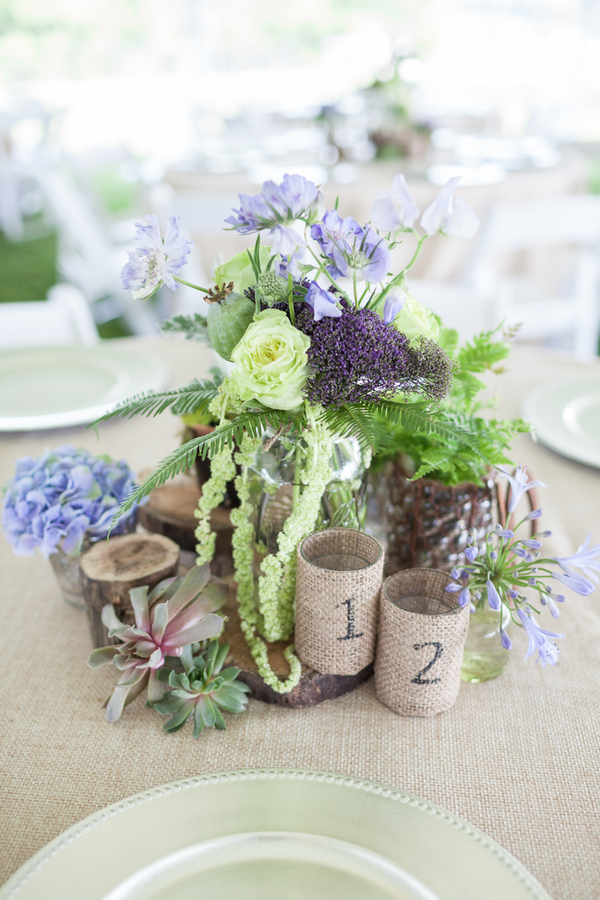 rustic+wedding+shabby+chic+summer+spring+burlap+moss+green+purple+violet+lavender+mint+emerald+outdoor+horse+cowboy+centerpiece+cake+table+dessert+candy+buffet+1326+studios+15 - Rustic Springtime