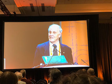 David Gross, APS 2019 President, welcomes everyone to Denver and the first session of the day