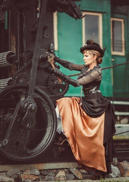 Steampunk woman wearing black and bronze clothing (skirt, corset, blouse, belt, hat). Women's Steampunk fashion