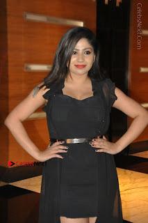 Telugu Actress Model Madhulagna Das Latest Spicy Stills in Black Short Dress  0026.JPG