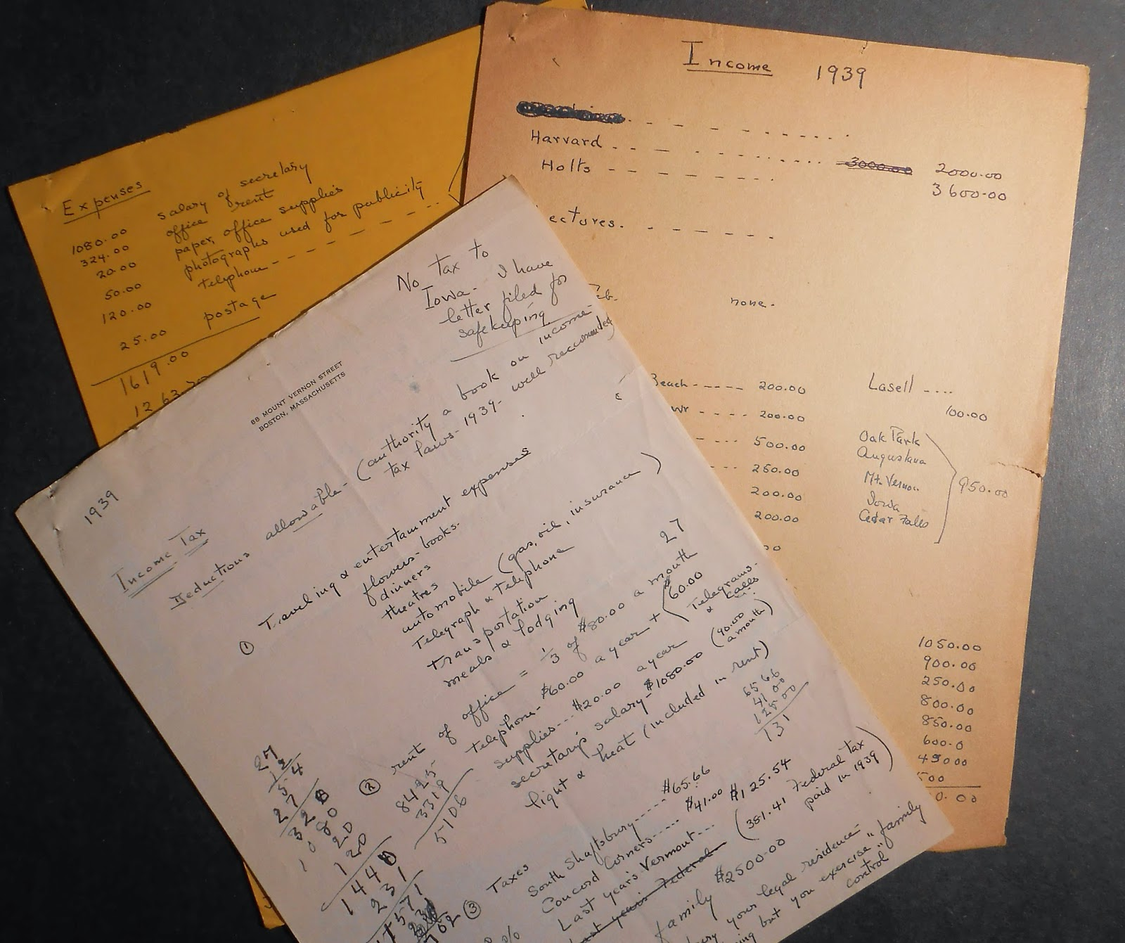 A pile of handwritten papers on financial matters.