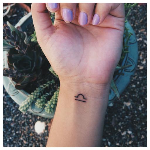 Centrado Libra simbolo no pulso