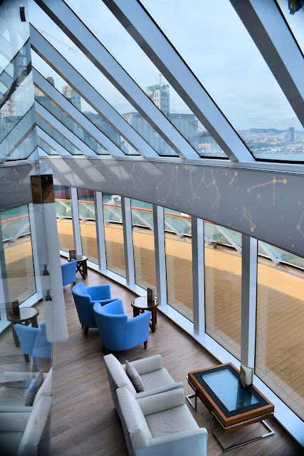 Explorer's Lounge on the Viking Star offers stunning views of the horizons ahead. Note the constellations on the band of wall between the two decks as well as the interactive coffee table at the bottom of the photo.