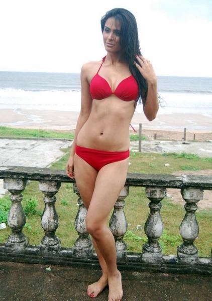 Ishita Sharma Hot Photos with Gun in Red Dress near Green Mountain - Photoshoot