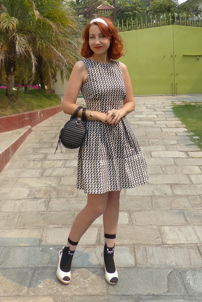Cat print dress, sandals over socks trend