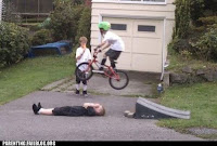 kid jumping over another kid on a bike