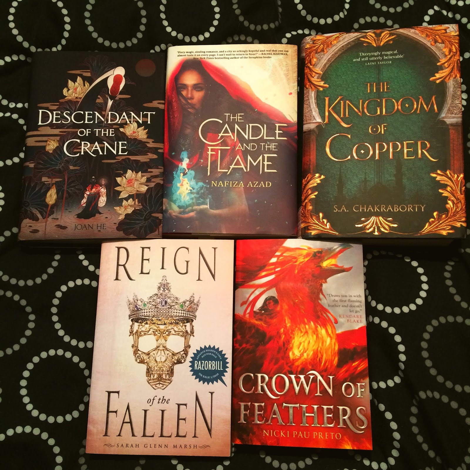 Photo of Descendant of the Crane by Joan He, The Candle and the Flame by Nafiza Azad, The Kingdom of Copper by S. A. Chakraborty, Reign of the Fallen by Sarah Glenn Marsh, and Crown of Feathers by Nicki Pau Preto